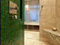 GREEN ACCENT WALL TILE IN BATHROOM